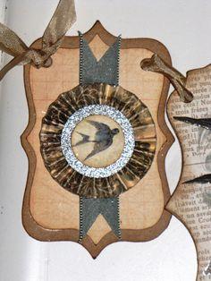 Vintage Inspired SOAR Banner Garland Victorian Paper Rosettes Tan Brown Cream Aqua blue BIRD. $25.00, via Etsy.