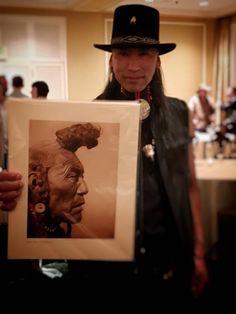 Art Cedar holds a featuring his grandfather, respected Blackfoot medicine man