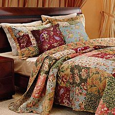 @Overstock.com - Antique Chic King-size 5-piece Quilt Set - Vibrant floral and paisley prints highlight this oversized king-size quilt set. Constructed of soft cotton, the quilt reverses from a lovely patchwork to a vintage-inspired floral back.  http://www.overstock.com/Bedding-Bath/Antique-Chic-King-size-5-piece-Quilt-Set/3915400/product.html?CID=214117 $119.99
