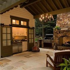 Outdoor kitchen with Gray Barn Doors on Rails