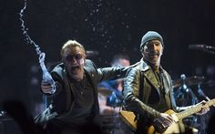 U2, Rogers Arena, Vancouver, review: 'you'll never have seen anything like it' Bono throws water at the crowd as U2 perform in Vancouver