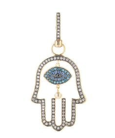 Annoushka, Mythology Hand of Fatima Amulet, £1,800.00. 18ct yellow gold Hand of Fatima amulet featuring a blue sapphire and micro-pavé blue diamond eye charm with single rose cut black diamond in the centre, freshwater pearl suspended beneath, surrounded by a micro-pavé set diamond hand charm with black rhodium finish, and diamond set bale.