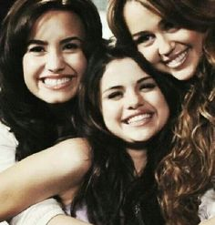 Selena gomez with demi lovato and miley cyrus.. miss them together again :)