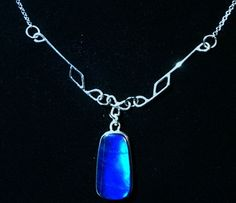 A SPECTROLITE CLASSIC necklace, crystal 25mm x 14mm,