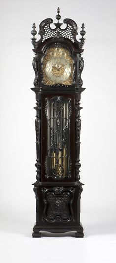 A nine-tube chiming mahogany longcase clock, Early 20th century, probably British, the movement stamped ''C.R.C. / C.R. Crookshank / 9974'' and ''3476'', the engraved brass dial with silver chapter ring with raised gilt brass Arabic hour numerals, 4 silvered subsidiary seconds dials, regulation for strike / silent and chime / silent, attached to a three-train quarter chiming and hour strike movement with Westminster and Whittington chimes, within a heavily carved, glazed case.