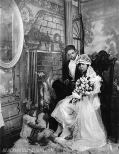 Here Comes The Bride II | 1920s    African American bride and groom posing for their formal wedding portrait, circa 1920s. Note the ghostly image of a child next to the newlyweds possibly suggesting the couple's future. James Van Der Zee, photographer. African American Vernacular Photography courtesy of Black History Album.