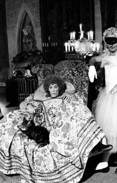 Peter O'Toole - in Elizabethan Drag - with tabby cat.
