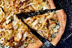 This luxurious pizza is topped with tender caramelized onions spread over a creamy mixture of ricotta, Parmesan cheese and chopped Swiss chard.