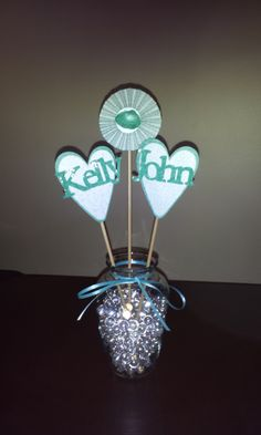 Bridal shower centerpiece for beach wedding. Hearts and rosettes in vase