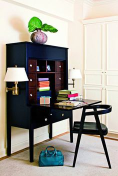 elle decor black secretary desk with brass sconce lighting