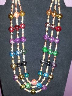 Multi color beaded glass triple strand necklace, on sterling silver plated wire and clasp on Etsy, $19.00