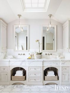 Completely redone with a fresh, simple feel and attention to detail, the master bathroom features custom built-in double vanities topped with honed Calacatta, installed by JB Tile & Stone. Pendants above are by Waterworks. Wall-mounted faucets are from Lefroy Brooks' 1930s Mackintosh range.: