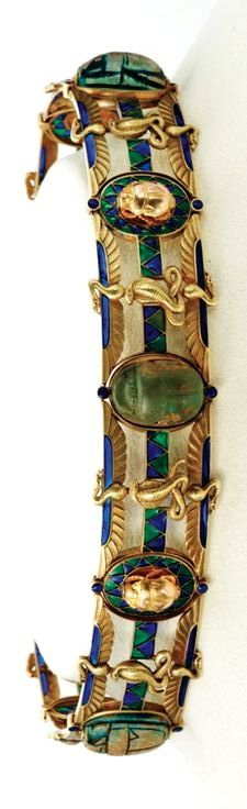 Egyptian Revival 18-karat gold, enamel and stone scarab choker. Maurice Robin et Cie, France, c. 1900. In between the links are four ancient glazed steatite scarabs and one hardstone scarab dating from the New Kingdom (1550-1070 B.C.)