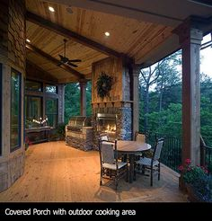 covered porch with fireplace and grill