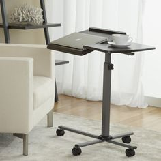 Laptop Reading Table Espresso // I have this: use it every single day! So useful for the couch-office :)