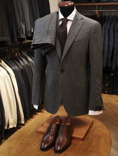 Solid gray flannel in perfect proportion, dull tie & shined shoes. Works every time . . .