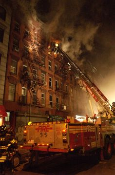 FDNY members respond to a 3-alarm fire in Manhattan, 2004.