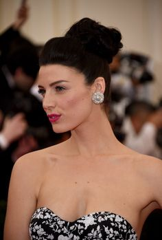Pin for Later: Stunning Beauty Looks From the 2014 Met Gala Jessica Paré Berry lips, bold brows, and a jet-black topknot pulled together Jessica's Met Gala look nicely.