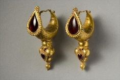 Pair of Gold & Garnet Earrings  --  Parthian  --  2nd Century CE  --  Photo courtesy of Bridgeman Art Gallery  --  Belonging to a private collection.
