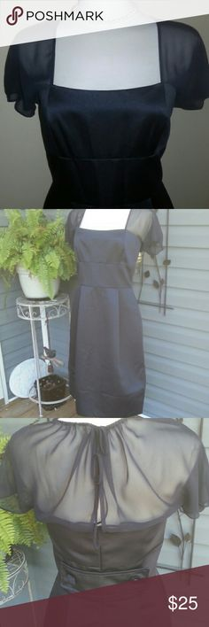 "Vera Wang Navy Satin/sheer sleeve Chic stylish sophisticated as only Vera does.  Perfect for any semi form affair.   This dress was worn once.  Sheer shoulders back and ss .  There is a slim drawstring around the neckline that you can adjust to your liking.  Fully lined.  True Navy.  Top to hem 40.5"".  It does have a 5"" seam around the bottom that could easily be removed and the dress would be 5"" shorter if desired.  Waist 15"" Vera Wang Dresses"