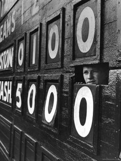 Boy Running Scoreboard at Griffith Stadium During the Baseball Game by Hank Walker. Photographic print from Art.com.
