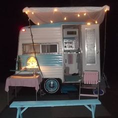 Vintage Camper at Night...now thats a tiny cutie!