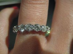 eternity 17 20-point stones for a TCW of 3.4. The setting is a platinum U-prong and my finger size is 6.25