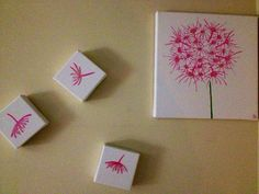 This is a multi canvas dandelion painting and there are sparkles over top of the pink as well.