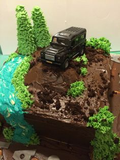 4x4 Off-road themed cake. Chocolate cake, with chocolate buttercream and chocolate ganache. Decorated using grass piping tip and leaf tip. Handmade by Smiffies Delicious Delights