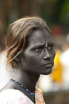 "Like Krishna, this woman is blue black — the blackest blue. Her name is Kushite and she's an Indian Beggar in Mumbai, South India. She is subject to extensive prejudice cause of her dark blue skin! She is Dravidian — The ancient ""blue race"" of India and it still exists in the bloodlines up to today."