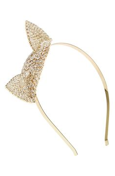 A pair of pointy cat ears encrusted in sparkling crystals glam up this skinny goldtone headband.