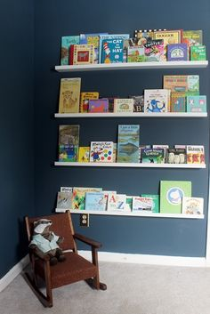 Ikea Ribba ledges - think this is how I will display the kids' books when we get their new beds set up