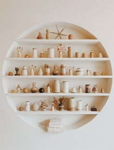 circle shelving and ceramic collection inside home of mason st. / sfgirlbybay circle shelving and