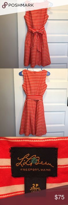 L.L. Bean Signature Poplin Dress Classic fit-and-flare dress that falls at the knee, orange and cream stripe pattern. Side pockets, concealed back zipper, 100% cotton shell and lining, removable fabric belt. Size 2 Petite. Petite sizes are no longer carried for this dress, so it's perfect for those who run smaller than regular 2. Model is wearing the same dress in a different color. L.L. Bean Dresses Midi