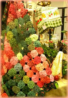 Yo-Yo Lap Quilt by AnnieElf, via Flickr.  PRETTY colors-LOVE!  Reminds me of the summer flowers at The Grand Hotel.