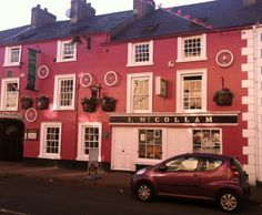 McCollam's Restaurant and Pub went completely pink for the Giro d'Italia, and hung a lot of bicycle wheels on the building for good measure. Bicycle Race, My Dream, Ireland, Irish, Wheels, Restaurant, Posts, Mansions, House Styles