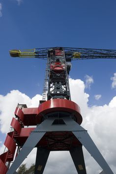 This unique hotel building, integrated into a harbour crane, is an extraordinary remnant of industrial culture. Guests are offered an extravagant experience in exclusive accommodation commanding a magnificent view of Amsterdam. Forty-fife metres (147 feet) above the ground, the Mystique Suite boasts seductive colours, sumptuous fabrics, highend materials, and extraordinary designer furniture. Get the same look with GROHE Allure #crane #grohe