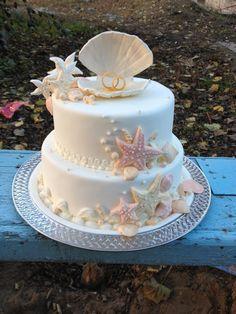 Beach wedding cake inspiration with soft colour