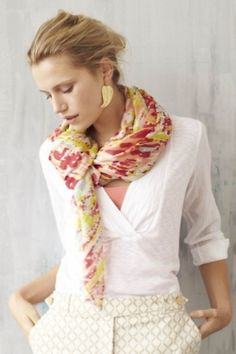 Great colors in the scarf and love the patterned pants with the simple white blouse.