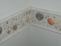 I wanted to do something with all the shells I have collected over the years. This is my creation. It is so cool. The shell strip goes completely around my bathroom wall. I love it.