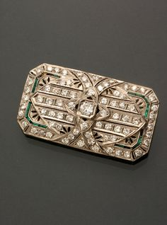Jewelry, Coins & Watches - Sale 1285 - Lot 120 - ADAM A. WESCHLER & SON, INC : AUCTIONEERS AND APPRAISERS - SINCE 1890 Art Deco Platinum Diamond and Synthetic Emerald Brooch Circa 1920-1930