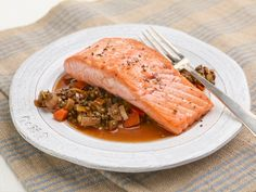 Salmon with Lentils recipe from Ina Garten via Food Network   ***Even brown lentils need at least an additional 10-15 minutes to cook.  Beware: the oils from the pan and salmon will make a mess of the oven