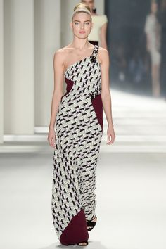 Geometric print with block color. The one shoulder look makes this dress youthful and fun.