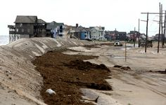 The stretch heading north out of Mirlo Beach on Hatteras Island is covered with sand and seaweed after a storm.