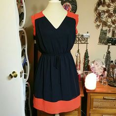 NWOT Navy and Orange Dress BOGO 30%. NWOT dress that's navy and orange color. Has slight extended sleeve, center tie but non functional, fully lined and Skirt lining matches skirt coloring with bottom of lining being orange. Size is Large but it's Juniors Large should be fine for women medium. Brand is Sweet Storm, 100% polyester. Length is finger tip on 5'6 height. Very cute to throw on & go, I'd keep but my rear-end lifts the back too much :( Price dropped! Dresses