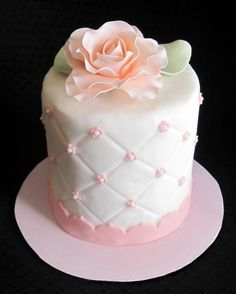 simle elegant mother of the Bride cake - 4 inch individual cake covered in white fondant, quilted with edible pearls and a gum paste rose. Not too shabby for my first attempt at gumpaste flowers.