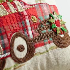With embroidered details and plaid flannel piping around the edges, our vintage-inspired pillow is a cozy, textural treat. A charming addition to your seasonal decor, it depicts an iconic holiday scene: the family car bound for home with the perfect Christmas tree on top.