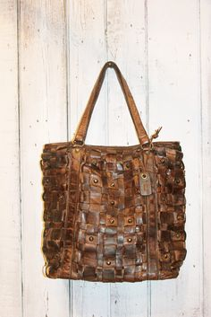 Handmade woven leather bag INTRECCIATO 1 by LaSellerieLimited