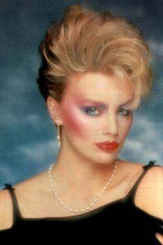 Now this is what I remember of makeup in the 80's, way too much blusher, blue eyeshadow, statement eyebrows and over glossed red lipstick! Not to mention the whole can of hairspray this look probably took to achieve! #TSVDAYCOMP