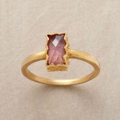 Whoa!  Looks just like my wedding ring, but mine is a princess cut diamond & round!  Bezel ring.